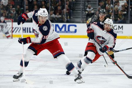 Columbus Blue Jackets center Alexander Wennberg (10) skates up the ice against the Vegas Golden Knights during the first period of an NHL hockey game, in Las Vegas