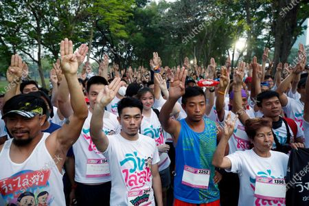 Thai anti-government runners flash a three-finger salute as they take part in the 'Run Against Dictatorship', a political rally event at a public park in Bangkok, Thailand, 12 January 2020. Thousands of people took part in the morning jog anti-government rally event 'Run Against Dictatorship' dubbed in Thai as 'Run to Oust Uncle', a subtle reference to Thai Prime Minister Prayut Chan-o-cha, while a rival group held the 'Walk to Cheer Uncle' to support the government.