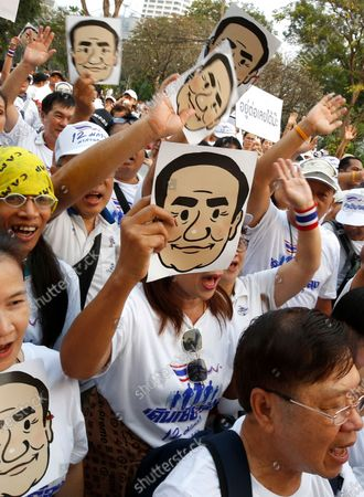 Supporters cheer and hold masks of Thai Prime Minister Prayut Chan-o-cha as they participate in the 'Dern Cheer Lung' or 'Walk for Prayut' event at Lumpini Park in Bangkok, Thailand, 12 January 2020. Thousand supporters gathered for the walking event organized to show support for Thai Prime Minister Prayut Chan-o-cha, and to demand that he remain prime minister of the country.