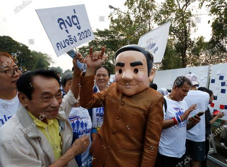 A supporter wears a costume of Thai Prime Minister Prayut Chan-o-cha (C) as they participate in the 'Dern Cheer Lung' or 'Walk for Prayut' event at Lumpini Park in Bangkok, Thailand, 12 January 2020. Thousand supporters gathered for the walking event organized to show support for Thai Prime Minister Prayut Chan-o-cha, and to demand that he remain prime minister of the country.