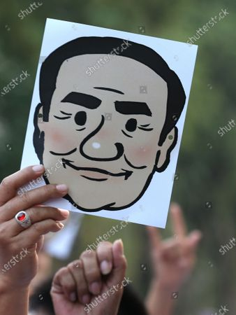 A supporter cheers and holds a mask of Thai Prime Minister Prayut Chan-o-cha as they participate in the 'Dern Cheer Lung' or 'Walk for Prayut' event at Lumpini Park in Bangkok, Thailand, 12 January 2020. Thousand supporters gathered for the walking event organized to show support for Thai Prime Minister Prayut Chan-o-cha, and to demand that he remain prime minister of the country.