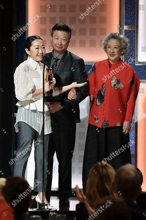 Lulu Wang,Tzi Ma, Zhao Shuzhen. Lulu Wang, from left, Tzi Ma and Zhao Shuzhen accept the award for Best Intergenerational Film at the 19th Annual Movies For Grownups Awards at the Beverly Wilshire Hotel, in Beverly Hills, Calif