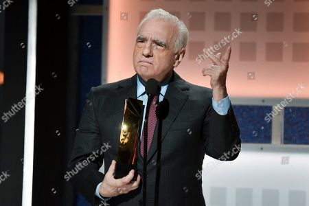 Martin Scorsese accepts the award for Best Director at the 19th annual Movies For Grownups Awards at the Beverly Wilshire hotel, in Beverly Hills, Calif