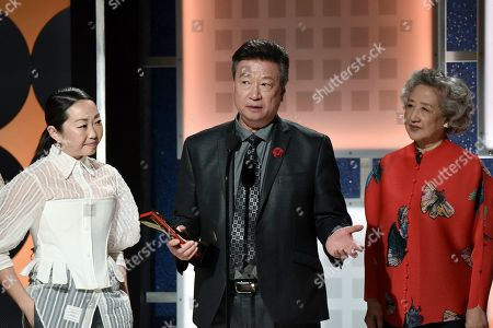 Lulu Wang, Tzi Ma, Zhao Shuzhen. Lulu Wang, from left, Tzi Ma and Zhao Shuzhen accept the award for best intergenerational film at the 19th annual Movies For Grownups Awards at the Beverly Wilshire Hotel, in Beverly Hills, Calif