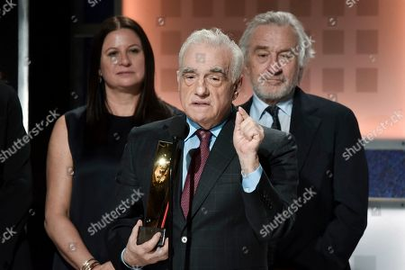 Emma Tillinger Koskoff, Martin Scorsese, Robert De Niro. Emma Tillinger Koskoff, from left, Martin Scorsese and Robert De Niro accept the award for best movie fo grownups at the 19th annual Movies For Grownups Awards at the Beverly Wilshire Hotel, in Beverly Hills, Calif
