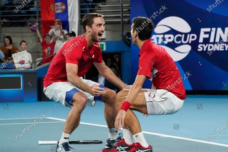 Novak Djokovic (R) and Viktor Troicki of Serbia celebrate their win in their doubles final against Pablo Carreno Busta and Feliciano Lopez of Spain on day 10 of the ATP Cup tennis tournament at Ken Rosewall Arena in Sydney, New South Wales, Australia, 12 January 2020.