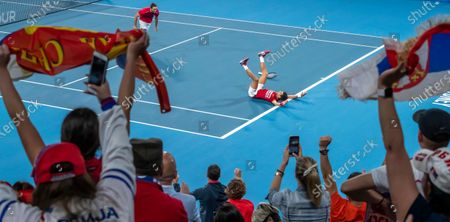 Novak Djokovic and Viktor Troicki of Serbia celebrate after winning the doubles match and tournament against Feliciano Lopez and Pablo Carreno Busta of Spain on day 10 of the ATP Cup tennis tournament at Ken Rosewall Arena in Sydney, New South Wales, Australia, 12 January 2020.