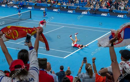 Novak Djokovic and Viktor Troicki of Serbia celebrate after winning the doubles match and tournament against Feliciano Lopez and Pablo Carreno Busta of Spain during the final on day 10 of the ATP Cup tennis tournament at Ken Rosewall Arena in Sydney, New South Wales, Australia, 12 January 2020.