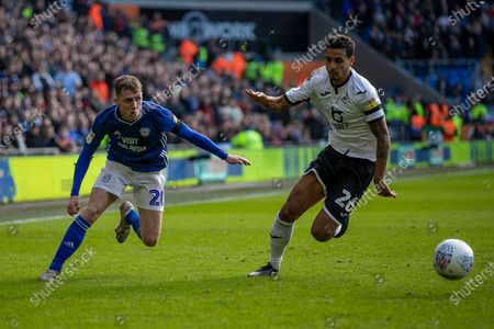 Stock Picture of Kyle Naughton of Swansea City and Gavin Whyte of Cardiff City chase for the ball during the EFL Sky Bet Championship match between Cardiff City and Swansea City at the Cardiff City Stadium, Cardiff