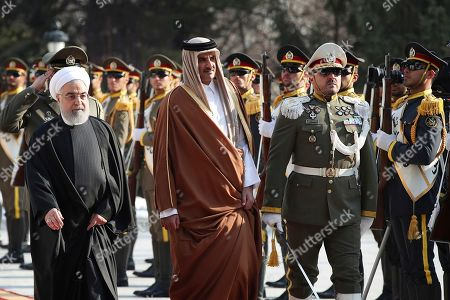 Tamim bin Hamad Al Thani, Hassan Rouhani. In this photo released by official website of the Office of the Iranian Presidency, Emir of Qatar Sheikh Tamim bin Hamad Al Thani, center, reviews an honor guard as he is welcomed by Iranian President Hassan Rouhani, left, in an official arrival ceremony at the Saadabad Palace in Tehran, Iran