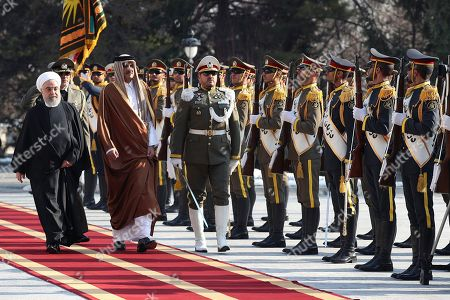 Tamim bin Hamad Al Thani, Hassan Rouhani. In this photo released by official website of the Office of the Iranian Presidency, Emir of Qatar Sheikh Tamim bin Hamad Al Thani, second left, reviews an honor guard as he is welcomed by Iranian President Hassan Rouhani, left, in an official arrival ceremony at the Saadabad Palace in Tehran, Iran