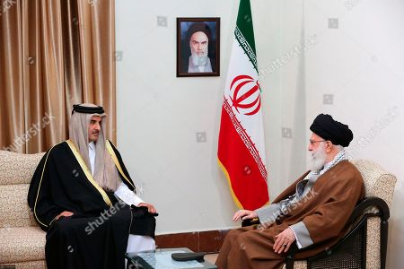 Tamim bin Hamad Al Thani, Ali Khamenei. In this photo released by an official website of the office of the Iranian supreme leader, Supreme Leader Ayatollah Ali Khamenei, right, meets Emir of Qatar Sheikh Tamim bin Hamad Al Thani at his office in Tehran, Iran