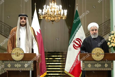 In this photo released by official website of the Office of the Iranian Presidency, President Hassan Rouhani, right, speaks during a joint press briefing with the Emir of Qatar Sheikh Tamim bin Hamad Al Thani, after their meeting, at the Saadabad Palace in Tehran, Iran