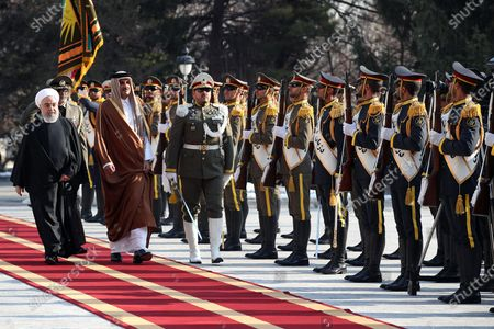 A handout photo made available by the presidential office shows Iranian President Hassan Rouhani (L) receiving Emir of Qatar Sheikh Tamim bin Hamad al-Thani (2-L) during a welcoming ceremony in Tehran, Iran, 12 January 2020. According to reports, Sheikh Tamim is visiting Tehran amid regional tension.