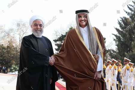 A handout photo made available by the presidential office shows Iranian President Hassan Rouhani (L) receiving Emir of Qatar Sheikh Tamim bin Hamad al-Thani (R) during a welcoming ceremony in Tehran, Iran, 12 January 2020. According to reports, Sheikh Tamim is visiting Tehran amid regional tension.