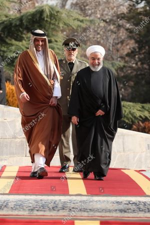 A handout photo made available by the presidential office shows Iranian President Hassan Rouhani (R) receiving Emir of Qatar Sheikh Tamim bin Hamad al-Thani (L) during a welcoming ceremony in Tehran, Iran, 12 January 2020. According to reports, Sheikh Tamim is visiting Tehran amid regional tension.