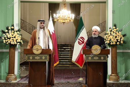 A handout photo made available by the presidential office shows Iranian president Hassan Rouhani (R) and Emir of Qatar Sheikh Tamim bin Hamad al-Thani (L) during a joint presser in Tehran, Iran, 12 January 2020. According to reports, Sheikh Tamim is visiting Tehran amid regional tension.