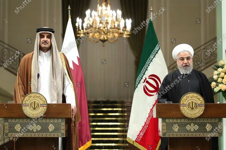 Stock Photo of A handout photo made available by the presidential office shows Iranian president Hassan Rouhani (R) and Emir of Qatar Sheikh Tamim bin Hamad al-Thani (L) during a joint presser in Tehran, Iran, 12 January 2020. According to reports, Sheikh Tamim is visiting Tehran amid regional tension.