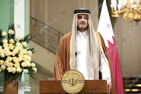 A handout photo made available by Iran's Presidential Office shows Emir of Qatar Sheikh Tamim bin Hamad al-Thani attending a joint press conference with Iranian President Rouhani following their meeting in Tehran, Iran, 12 January 2020. According to reports, Sheikh Tamim is visiting Tehran amid regional tension.