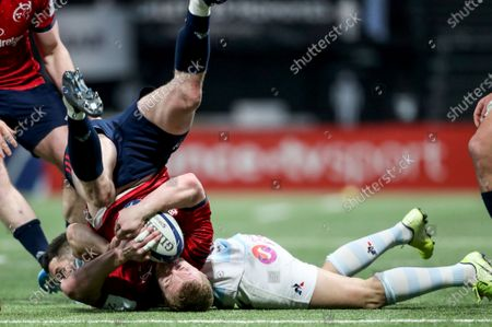 Racing 92 vs Munster. Munster's Keith Earls and Racing 92's Brice Dulin