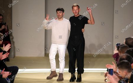 Stock Photo of Designers Guillaume Meilland (L) and Paul Andrew appear on the catwalk at the end of the Salvatore Ferragamo show during the Milan Fashion Week, in Milan, Italy, 12 January 2020. The Fall-Winter 2020-21 men's collections are presented at the Milano Moda Uomo from 10 to 14 January.