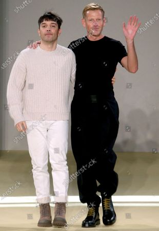 Designers Guillaume Meilland (L) and Paul Andrew appear on the catwalk at the end of the Salvatore Ferragamo show during the Milan Fashion Week, in Milan, Italy, 12 January 2020. The Fall-Winter 2020-21 men's collections are presented at the Milano Moda Uomo from 10 to 14 January.