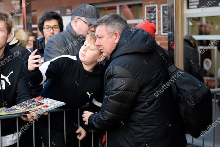 Watford assistant manager Craig Shakespeare has a selfie with a fan on arrival ahead of the Premier League match between Bournemouth and Watford at the Vitality Stadium, Bournemouth
