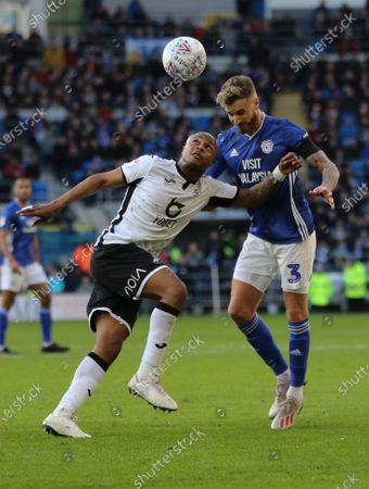 Andre Ayew of Swansea City and Joe Bennett of Cardiff City compete for the ball