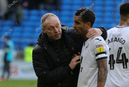 Swansea City head coach Steve Cooper with Kyle Naughton of Swansea City at the end of the match