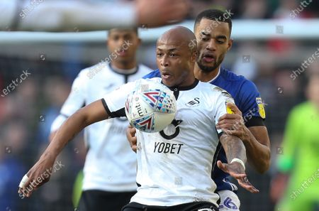 Andre Ayew of Swansea City holds off Curtis Nelson of Cardiff City
