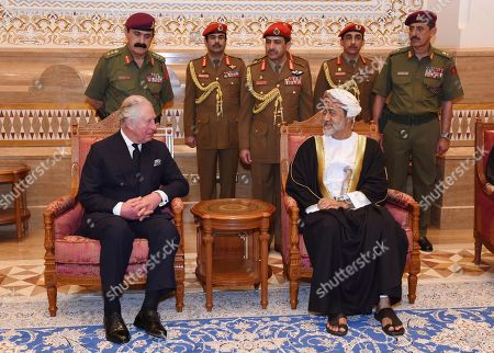 In this photo made available by Oman News Agency, Oman's new Sultan Haitham bin Tariq Al Said, right, receives Prince Charles after his arrival to attend the late Sultan Qaboos official mourning ceremony, in Muscat, Oman