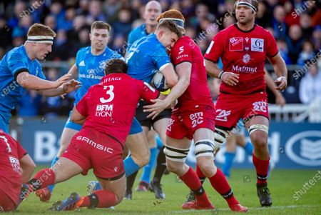 Leinster vs Lyon. Leinster's Garry Ringrose with Felix Lambey and Francisco Gomez Kodela of Lyon