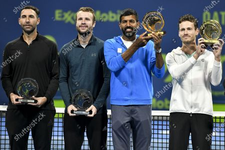 Wesley Koolhof (1st R) of the Netherlands and Rohan Bopanna (2nd R) of India pose with their trophies after winning the doubles final match