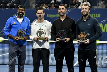 Wesley Koolhof (2nd L) of the Netherlands and Rohan Bopanna (1st L) of India pose with their trophies after winning the doubles final match