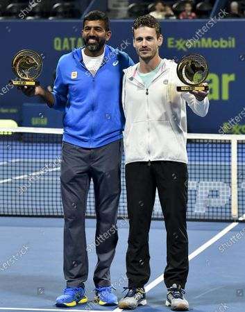 Wesley Koolhof (R) of the Netherlands and Rohan Bopanna (L) of India pose with their trophies after winning the doubles final match