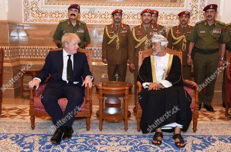 Haitham bin Tariq Al Said, Boris Johnson. In this photo made available by Oman News Agency, Oman's new sultan Haitham bin Tariq Al Said, right, receives Britain's Prime Minister Boris Johnson after his arrival to attend an official mourning ceremony for the late Sultan Qaboos, in Muscat, Oman