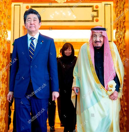 Salman, Shinzo Abe. In this photo released by Saudi Press Agency, SPA, Saudi King Salman, right, receives Japan's Prime Minister Shinzo Abe in Riyadh, Saudi Arabia