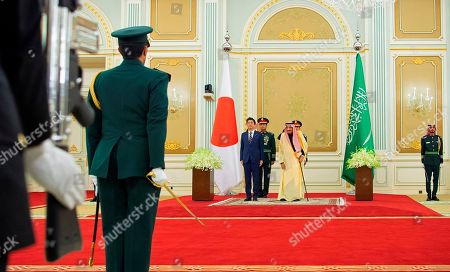 Stock Photo of Salman, Shinzo Abe. In this photo released by Saudi Press Agency, SPA, Saudi King Salman, center right, stands with Japan's Prime Minister Shinzo Abe, in Riyadh, Saudi Arabia