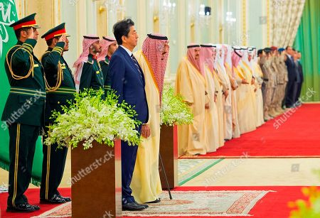 Salman, Shinzo Abe. In this photo released by Saudi Press Agency, SPA, Saudi King Salman, center left, stands with Japan's Prime Minister Shinzo Abe in Riyadh, Saudi Arabia