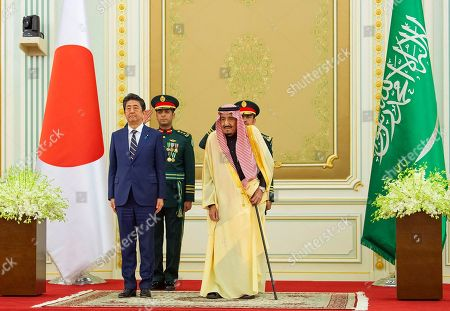 Stock Picture of Salman, Shinzo Abe. In this photo released by the Saudi Royal Palace, Saudi King Salman, right, receives Japan's Prime Minister Shinzo Abe, in Riyadh, Saudi Arabia