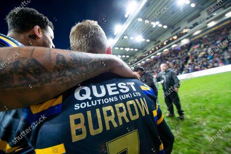 Leeds's Rob Burrow is hugged by Ryan Bailey after Jamie Jones-Buchanan's testimonial match.