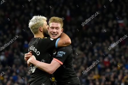 Manchester City's Sergio Aguero, left, celebrates with Manchester City's Kevin De Bruyne after scoring his side's fifth goal during the English Premier League soccer match between Aston Villa and Manchester City at Villa Park in Birmingham, England