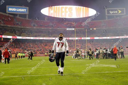 Houston Texans offensive tackle Chris Clark (77) walks off the field following an NFL divisional playoff football game against the Kansas City Chiefs, in Kansas City, Mo., . The Kansas City Chiefs won 51-31