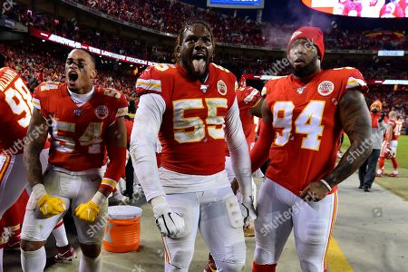 Stock Picture of Kansas City Chiefs defensive end Frank Clark (55), linebacker Damien Wilson (54) and defensive end Terrell Suggs (94) celebrated following an NFL divisional playoff football game against the Houston Texans, in Kansas City, Mo., . The Kansas City Chiefs won 51-31