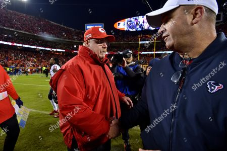 Kansas City Chiefs head coach Andy Reid, left, meets with Houston Texans head coach Bill O'Brien following an NFL divisional playoff football game, in Kansas City, Mo., . The Kansas City Chiefs won 51-31