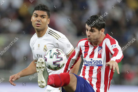Real Madrid's Casemiro vies for the ball with Atletico Madrid's Alvaro Morata during the Spanish Super Cup Final soccer match between Real Madrid and Atletico Madrid at King Abdullah stadium in Jiddah, Saudi Arabia