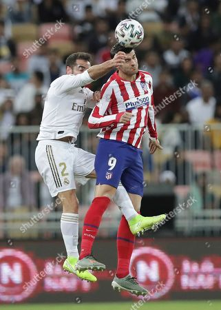 Real Madrid's Dani Carvajal, left, vies for the ball with Atletico Madrid's Alvaro Morata during the Spanish Super Cup Final soccer match between Real Madrid and Atletico Madrid at King Abdullah stadium in Jiddah, Saudi Arabia