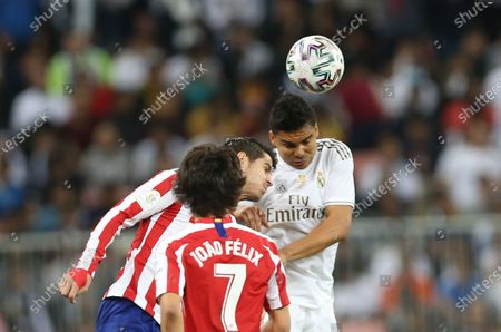 Real Madrid CF's Casemiro (R) in action against Atletico Madrid FC's Alvaro Morata (L) and Atletico Madrid FC's Joao Felix (C) during the Spanish Super Cup Final match between Atletico Madrid FC and Real Madrid CF at King Abdullah Sport City Stadium, Jeddah, Saudi Arabia, 12 January 2020.