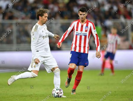 Real Madrid CF's Sergio Ramos (L) in action against Atletico Madrid FC's Alvaro Morata (R) during the Spanish Super Cup Final match between Atletico Madrid FC and Real Madrid CF at King Abdullah Sport City Stadium, Jeddah, Saudi Arabia, 12 January 2020.