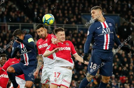 PSG's Mauro Icardi, right, and Monaco's Aleksandr Golovin, center, head the ball during the French League One soccer match between Paris-Saint-Germain and Monaco at the Parc des Princes stadium in Paris